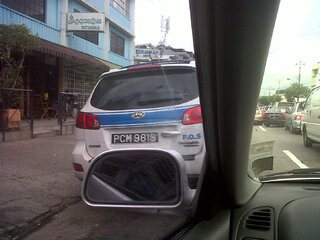 Illegal parking by police officer
